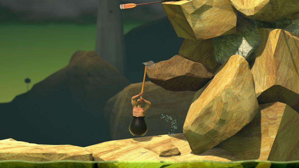 Hovedpersonen, en mann hvis torso stikker ut av en kjele bruker en slegge for å dra seg opp en fjellskrent.